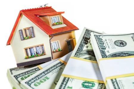 house with dollar bills