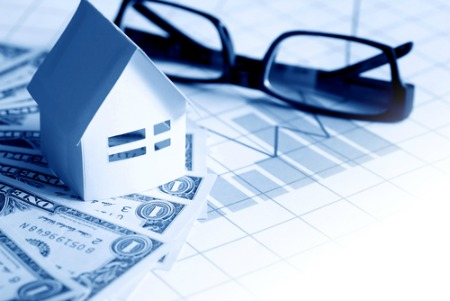 real estate market report concept with house, money, glasses, chart