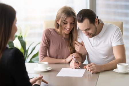 real estate couple signing
