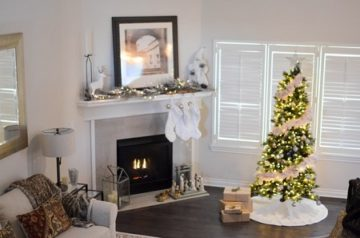 living room with a christmas tree near a fireplace